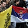 The Eastern Roman and Serbian flags side-by-side during the Serbian protest in Belgrade over Kosovo.