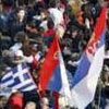 A Greek flag amidst Serbian flags during a mass Serbian protest rally in Belgrade over Kosovo.